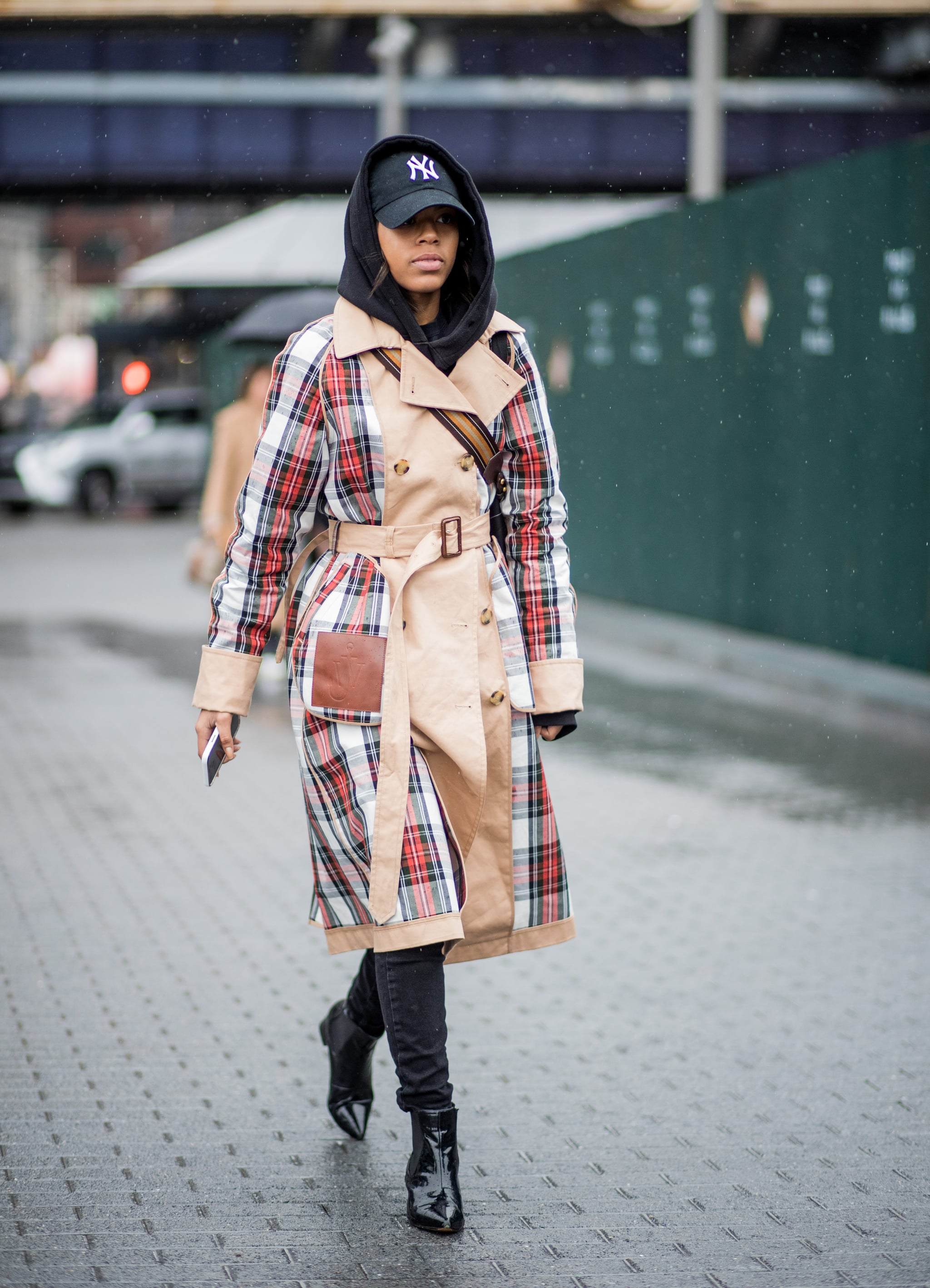 NEW YORK, NY - FEBRUARY 11: A guest wearing plaid J.W. Anderson trench coat seen outside Tibi on February 11, 2018 in New York City. (Photo by Christian Vierig/Getty Images)