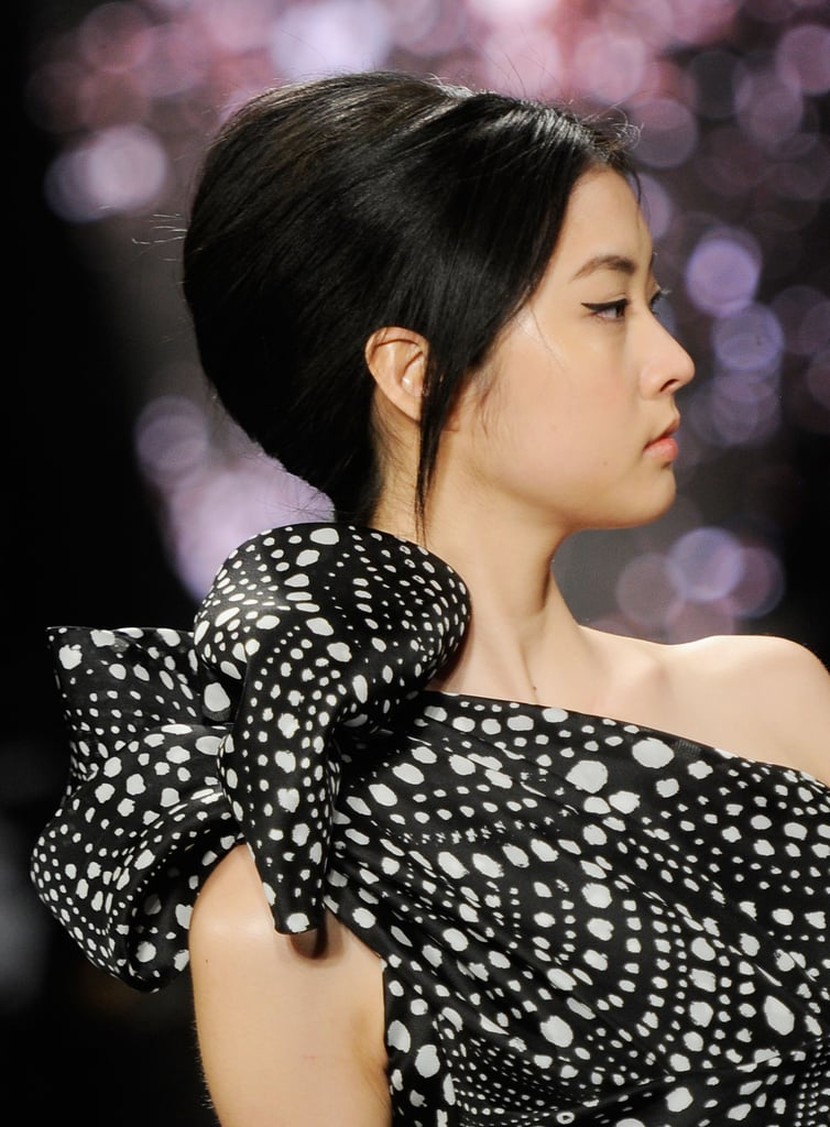 At Naeem Khan for Fall 2012, all kinds of hair textures were smoothed into chic minibeehives.