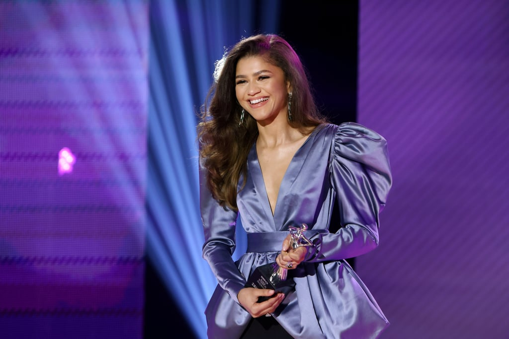 "Nothing says power like an exaggerated shoulder silhouette — just take a look at Zendaya's gorgeous outfit at Essence's Black Women in Hollywood Awards on Thursday night. But what made the actress's vintage blue-gray YSL top and slit maxi skirt even more striking was the special story behind the look.  Celebrity stylist and image architect Law Roach revealed Zendaya's top was originally a dress owned by Eunice Walker Johnson, the late Black businesswoman who changed fashion for Black women in the '60s and '70s. The trailblazer started Ebony Fashion Fair, a global fashion tour that showcased haute couture fashions for Black women, spotlighting Black models and designers in the process. Eunice had worn the silk dress, paired with a sleek black maxi skirt similar to Zendaya's, in an old issue of Ebony, as Law shared on his Instagram. The 1982 piece is from the stylist's personal archive. ""We pay homage 🌹🌹🌹,"" he wrote. Zendaya was honored for her contributions to Hollywood and global culture, along with Whoopi Goldberg, Cynthia Erivo, Michaela Coel, and Andra Day, on Thursday night. Ahead, get a closer look at Zendaya's timeless ensemble from all angles."
