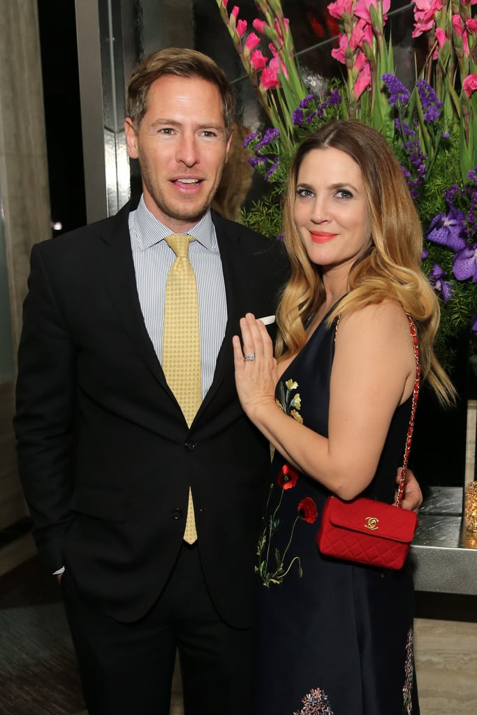 "Drew Barrymore had the support of her husband, Will Kopelman, at a screening of her latest film Miss You Already in NYC on Sunday night. Drew, who stars in the film with Toni Collette, showed lots of cleavage in a low-cut floral dress as she posed for photos with her costars on the red carpet and cozied up to Will inside. Drew recently made headlines when she bravely opened up about suffering from postpartum depression after the birth of her second daughter, Frankie, last year. Drew told People that she ""really got under the cloud,"" adding, ""It was just really challenging and I felt overwhelmed. I made a lot of decisions and I definitely changed my work life to suit my parenthood."" Keep reading to see photos of Drew's big night in NYC, and then see her cutest photos with Will over the years."