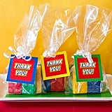 """Maegan filled up clear bags with Lego chocolates and attached """"Thank you!"""" tags to each one as an extra treat for the staff to take home with them. To see all of Maegan's Lego printables, visit her Etsy shop.  Related:  BAM! A Seriously Super Superhero Staff Appreciation Week Party Hats Off! A Seuss-ical Way to Celebrate Teacher Appreciation Week!"""