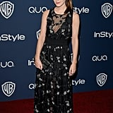 Emma Watson changed into a black dress before hitting the party circuit.