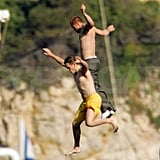 Matt Damon and Brad Pitt both jumped from the side of their vacation yacht in Villefranche, France, in May 2004.