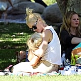Gwen Stefani held her little one in an LA park.