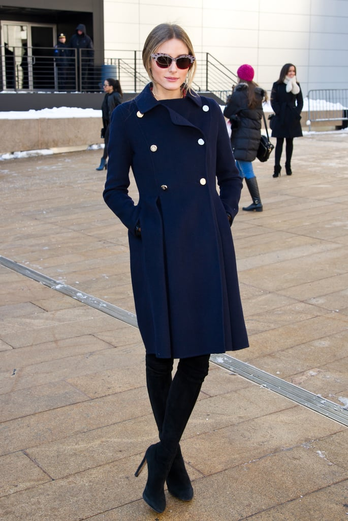 Outside Lincoln Center, the always chic Olivia layered up with a military-style coat.