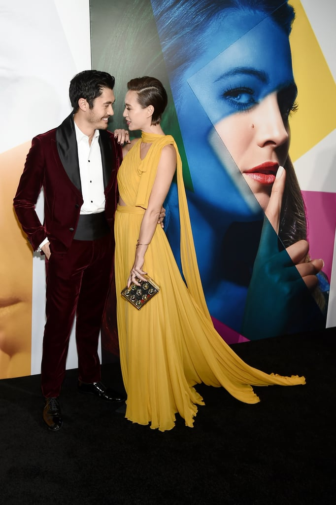 Step aside, Blake Lively and Ryan Reynolds, there's a new celebrity couple making us swoon on the red carpet. On Monday, Henry Golding and his wife Liv Lo stepped out for the premiere for A Simple Favour in NYC, and stole the spotlight (and our hearts) in the process. The actor and yoga instructor looked over the moon as they smiled for cameras inside the Museum of Modern Art. At one point, they seemed to get lost in their own world as they stared deep into each other's eyes.  This isn't the first time the two lovebirds have given us a glimpse of their undeniable bond. Henry and Liv looked like a modern-day Prince Charming and Cinderella as they attended the premiere of Crazy Rich Asians in their hometown of Singapore last month. What can we say? They really are fairy-tale perfect. See more of their adorable outing ahead.