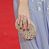 A snake ring and Lauren Merkin snake clutch toughened up Emily Blunt's Dior dress.