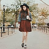 A Sweater Layered Over a Long-Sleeved Dress, Oxford Shoes, and a Wide-Brim Hat
