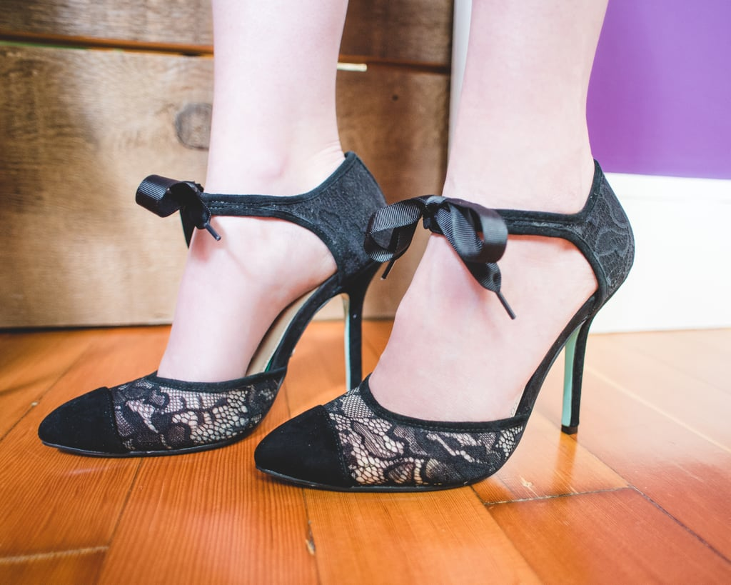 "These delicate lace heels feature a feminine ankle tie that's perfect for the holidays.    Shop Gifts For ""the Social Butterfly"":   Lady Love Song Dress in Merlot Velvet Berlin There, Done That Jacket Steadfast Tenacity Bootie Biologists' Ball Dress Tag, You're Glitz Clutch Queen of the Raffle Heel"