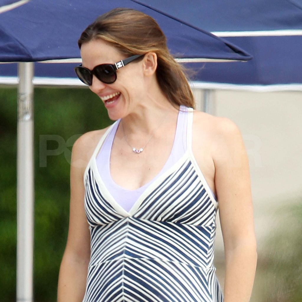 Jennifer Garner pregnant in a striped dress.
