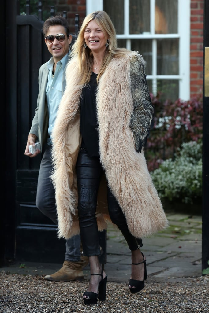The model was all smiles as she left her home in London.