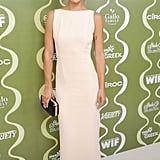 Jessica Szohr softened up in an off-white sleeveless midi dress, finished with a black box clutch and ankle-strap sandals.