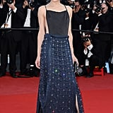 Milla Jovovich stepped out in a slinky black-and-navy Prada gown at Cleopatra's premiere.
