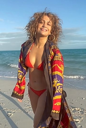 "Jennifer Lopez Wearing Red Bikini and ""J Lo"" Robe on Beach"