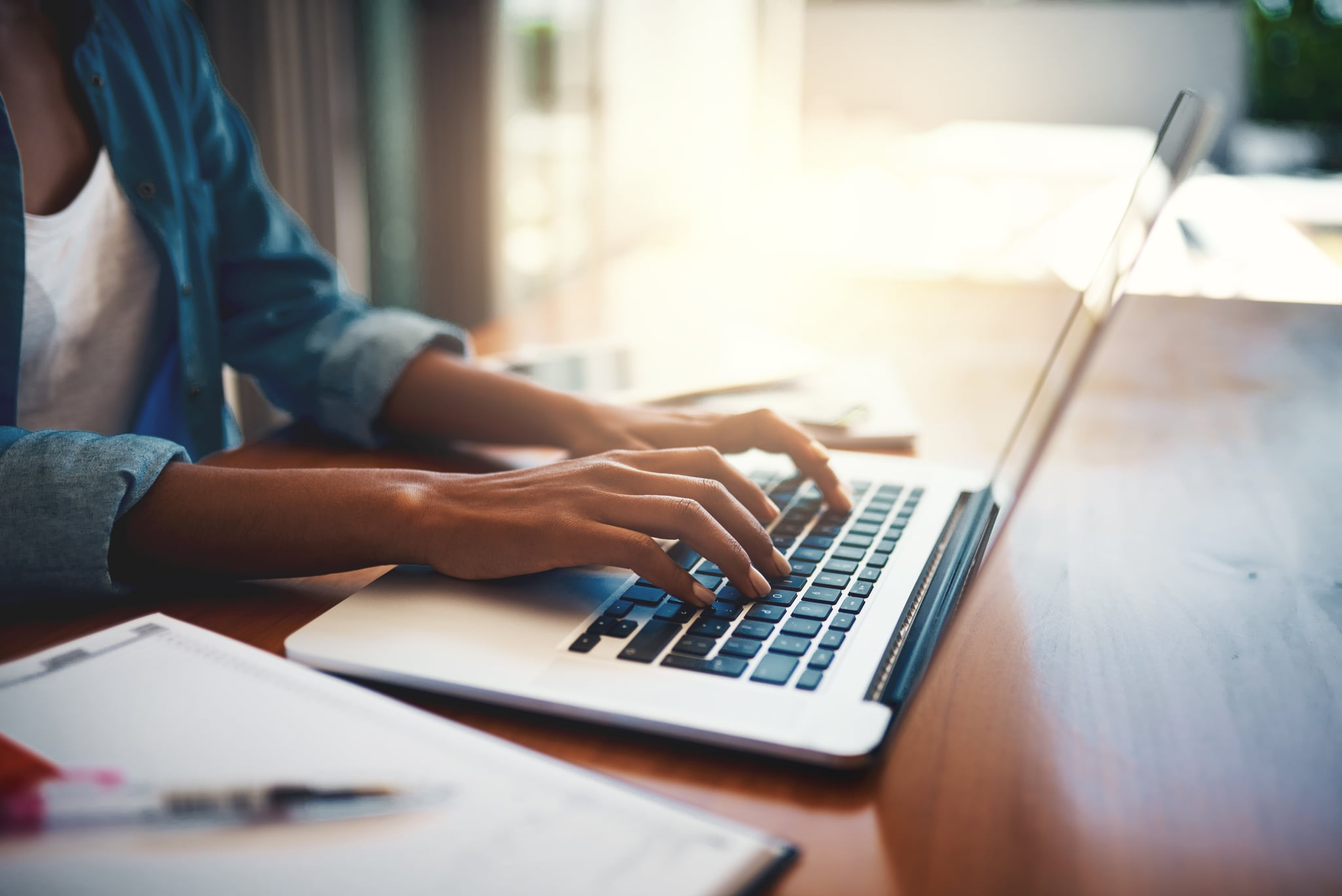 Closeup shot of an unrecognisable woman using a laptop while working from home