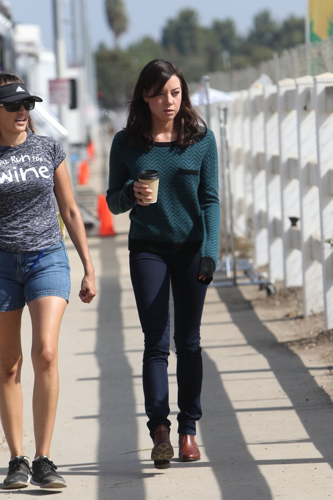 Aubrey Plaza grabs a cup of coffee on the set.