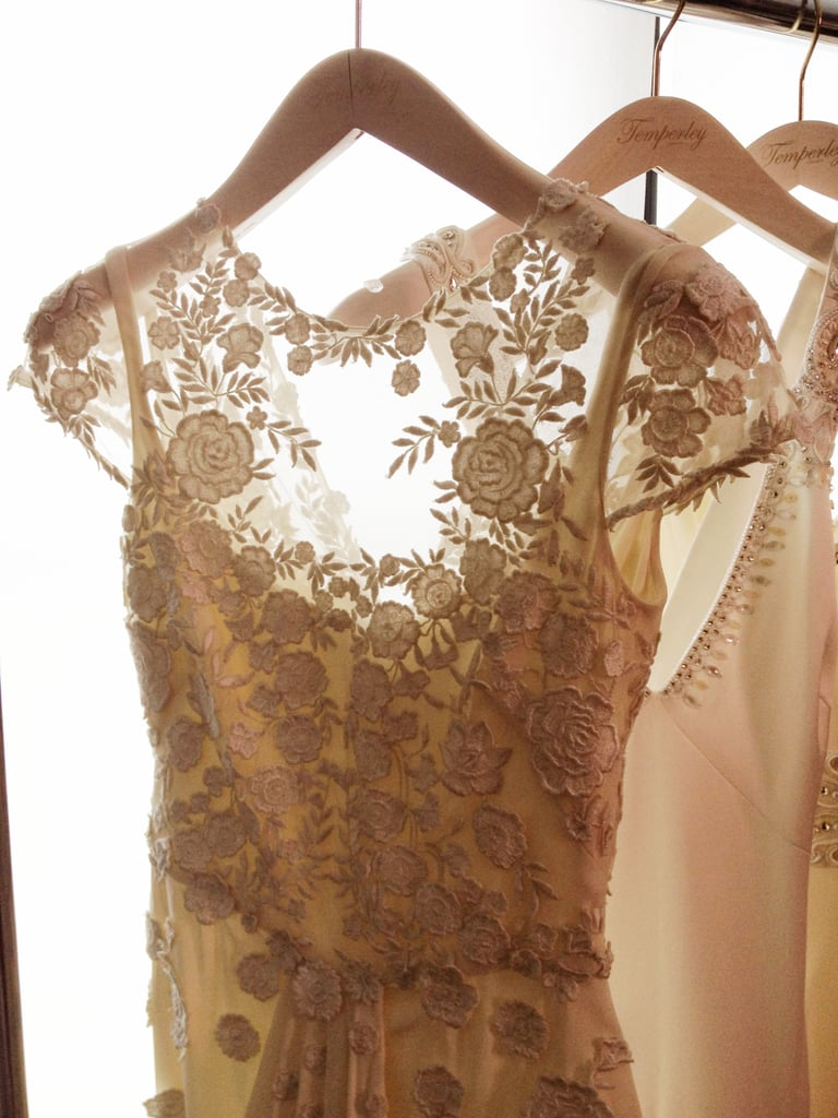 A beautiful Chantilly lace cap-sleeved gown with delicate embroidery.