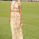 For a 2011 Santa Barbara polo match, Zoe Saldana chose a high-neck floral Chloé dress, Valentino heels, and a Lanvin clutch.