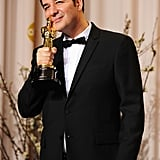 The Artist's composer, Ludovic Bource, smooched his Oscar for best original score in 2012.