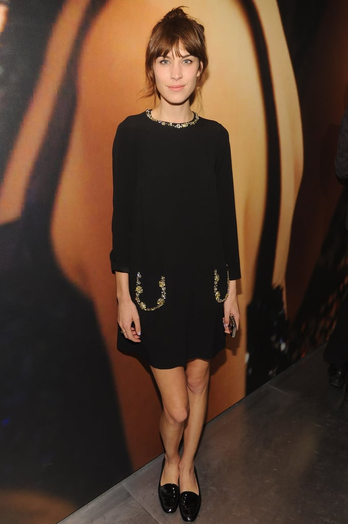 Alexa Chung opted for a more casual ensemble wearing a Miu Miu black silk crepe dress with crystal embellishments and finished off her look with black loafers at the Prada and The Great Gatsby cocktail party.