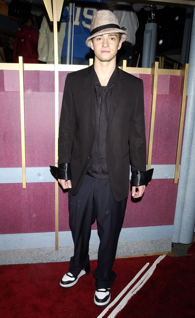 Justin accessorised his suit and tie with a wool fedora and cool kicks at the VMAs in 2002.