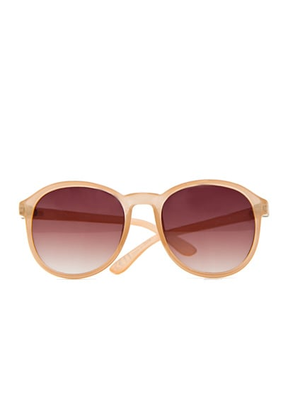 The soft pastel hue on these channels the on-trend, but subtly so.  Mango Round Sunglasses ($25)