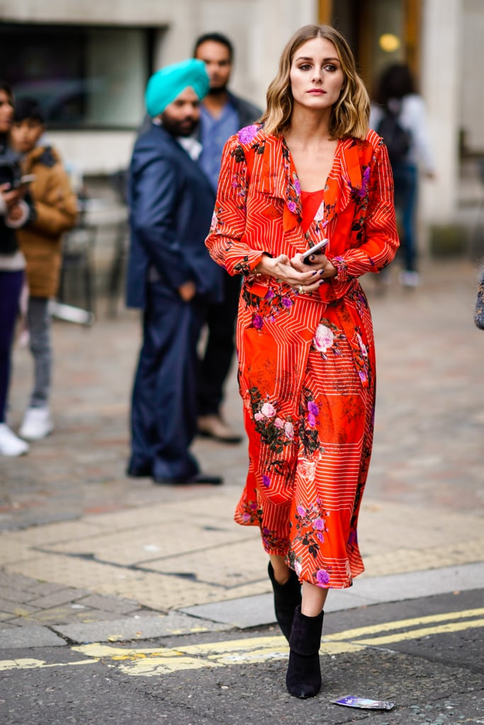 Olivia turned heads while making her way down the street in London in a Preen x L.K. Bennett dress and ankle boots.