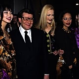 Yves smiled with a group of models, including Naomi Campbell and Carla Bruni, after his Fall '95 haute couture show.