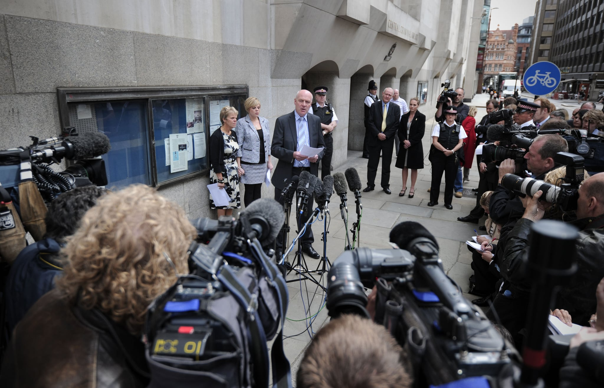The mother and sister of murdered schoolgirl Amanda Dowler, Sally (L) and Gemma (2nd L), listen as father Bob Dowler (3rd L) reads a statement outside the Old Bailey in central London, on June 24, 2011. Surrey Police apologised today for mistakes in the Milly Dowler investigation. Convicted killer Levi Bellfield was given a second whole-life jail term today for the murder of schoolgirl Milly Dowler. Relatives of the 13-year-old, snatched from the street on her way home in March 2002, hugged each other as Bellfield was told he would never be released. He is already serving a whole-life term for the murders of French student Amelie Delagrange and Marsha McDonnell and the attempted murder of Kate Sheedy.  AFP PHOTO / CARL COURT (Photo credit should read CARL COURT/AFP/Getty Images)