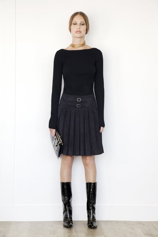 Knit Boatneck Top With Pleated Skirt Combo Dress in Black, Follow Me Patent Mid-Calf Boot in Black, Attraction Patent Shoulder Bag in Black. Photo courtesy of Tamara Mellon