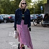 Wear a long blanket skirt with a denim jacket and shiny leather boots.