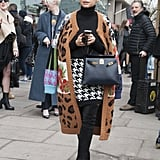 Miroslava Duma teams animal print and houndstooth perfectly.
