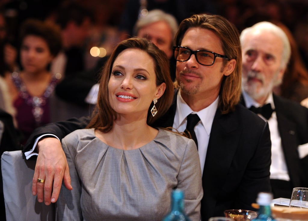 "Angelina Jolie and Brad Pitt continued their visit to Berlin today after he made a quick pit stop in London over the weekend to attend the BAFTAs. He was nominated for best actor at the British film celebration, which aired yesterday evening, though The Artist star Jean Dujardin ended up taking home the honor. Brad and Angelina first flew to Germany last week for the Berlin Film Festival, where Angelina hosted a premiere of her directorial debut In the Land of Blood and Honey. Angelina's film and her philanthropic ties are closely related, and today, she joined the prosecutor of the International Criminal Court for a workshop on sexual violence and child soldiers at a Berlin hotel. After the meeting, she reunited with Brad at the Cinema for Peace gala, where she was given an award for her film's message against genocide and war.  Before accepting the honor this evening, Angelina told reporters she hopes the movie is actually difficult for audiences to see. She said, ""It's a strange thing to say as a director and a filmmaker, but I want people to be very uncomfortable when they watch it, and they should be upset and they should want some intervention, and they should want it to stop and they should be angry."""