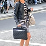 Pippa Middleton has her hands full with a laptop bag and large purse.