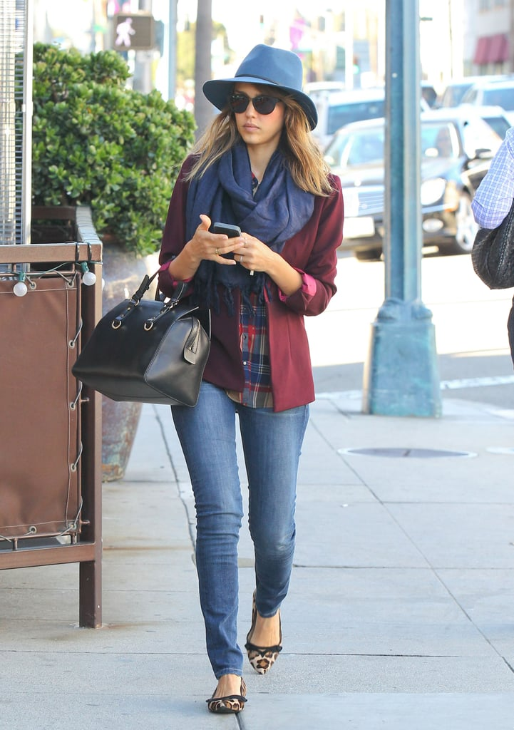 Jess was the epitome of Fall, topping her moody mixed-print palette — a rich Cameo blazer, plaid Marc by Marc Jacobs top, and leopard Tod's shoes — with a navy Janessa Leon fedora and classic DSquared2 leather tote.