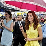 Kate Middleton braved the rain during her Solomon Island visit with a big pink umbrella.