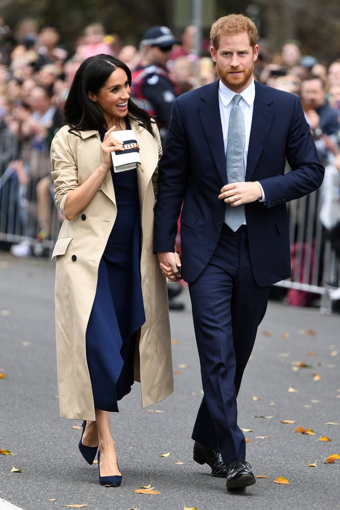 Meghan styled her red, white, and blue Gucci clutch with a navy Dion Lee dress, Martin Grant trench coat, and Manolo Blahnik pumps during her 2018 visit to Australia.