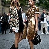 A gilded dress is a surefire way to get noticed on the streets of Paris.