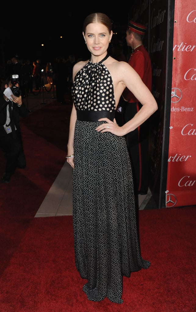 At the Palm Springs Film Festival, Amy Adams's Juan Carlos Obando gown was full of surprises, from its backless cut to its thigh-high slit.