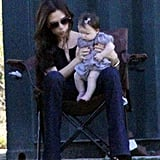 Harper Beckham inspected her toes and kept Victoria company while big brother Brooklyn played soccer at his October 2011 match in LA.