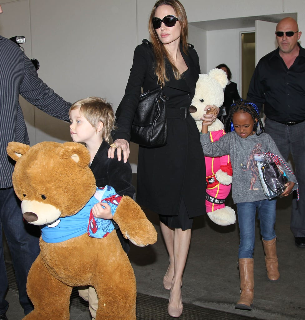 Angelina Jolie touched down in LA today with her oldest daughters, Shiloh and Zahara Jolie-Pitt. The trio are back from their two-day stopover in Amsterdam, where Shiloh and Zahara went sightseeing on a boat and Angelina attended court proceedings against Thomas Lubanga, a Congolese rebel. Zahara and Shiloh spent one-on-one time with Angelina after hanging out with Brad Pitt in New Orleans last week. The kids traveled with him to the Big Easy while he personally checked in on the progress of his Make It Right Foundation. Brad even hosted a fundraising event for his philanthropic organization with live entertainment provided by Sheryl Crow, Kanye West, Snoop Dogg, and Rihanna. The celebration raised more than $4 million to build homes for the residents of the Lower Ninth Ward.
