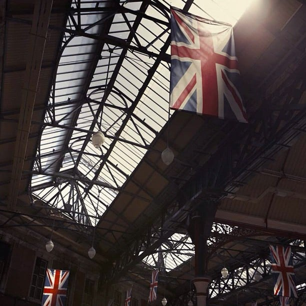 Burberry shared a patriotic look at flags inside London's Victoria Station. Source: Instagram user Burberry