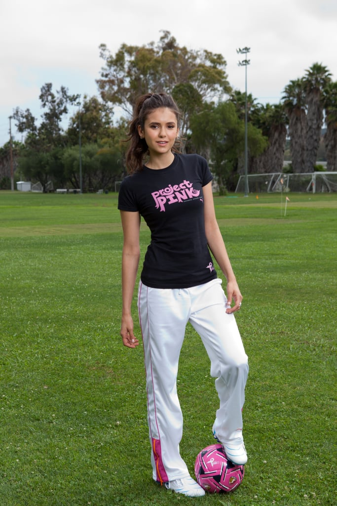 Nina Dobrev's new Puma Project Pink PSA debuted today. The Vampire Diaries star showed off her athletic side during the shoot, taking to the soccer field with a group of professional and young athletes to get the word out about the fundraising effort. The second-annual campaign asks soccer fans to vote for their favorite breast-cancer charity, with the winning cause receiving 100 percent of the proceeds from Puma's Project Pink collection. The sporty initiative wasn't the first time Nina's showed off her fit form and shared her love of working out. Nina was the cover girl for Seventeen's fitness issue earlier this Spring. The actress is keeping busy with her new philanthropic effort as she gears up for the September return of her hit CW show, but she also took a timeout during the hiatus to travel with her boyfriend and costar, Ian Somerhalder. Ian and Nina went to Paris with their moms before returning to LA for a bit and then hopping on another flight to shoot their upcoming season down South.