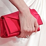 Angelina Jolie carried a red bag.