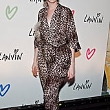 Anne Hathaway attended the Lanvin party in a leopard print jumpsuit.