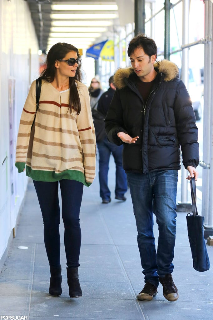 Katie Holmes chatted with a male companion in the NYC subway.