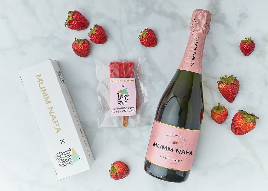 """Summer is officially in session, and if there's one thing that can make a sweltering hot day a little bit more bearable, it's a refreshing popsicle. And a boozy one at that? Sign us up. Tipsy Scoop, a New York-based shop famous for its liquor-infused ice cream, just teamed up with Mumm Napa sparkling wine to create a boozy popsicle made with fresh strawberries and lemons. Described as having """"vivid aromas of black cherries, red berries and citrus,"""" the popular bubbly is delightfully infused into these strawberry rosé lemonade pops.  Picture dunking one of these babies into an ice-cold glass of wine, though we imagine they taste just as delectable on their own, too. Luckily, we're not just teasing here — they're currently available to order nationwide and for purchase at Tipsy Scoop stores in New York for $20 per four-pack. And at five percent ABV, the adult-approved treats are worth every penny. Ahead, shop the summery snack and get ready to fill up that cooler.      Related:                                                                                                           Beat the Heat With This Summer's Tastiest Boozy Freeze Pops"""