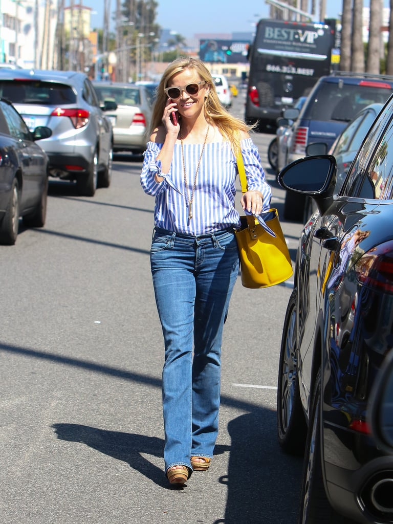 For a daytime casual look, Reese wore an off-the-shoulder striped shirt and bootleg jeans.