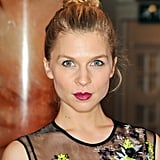 Clémence Poésy went for a simple but standout look with a topknot and a bold berry lipstick.