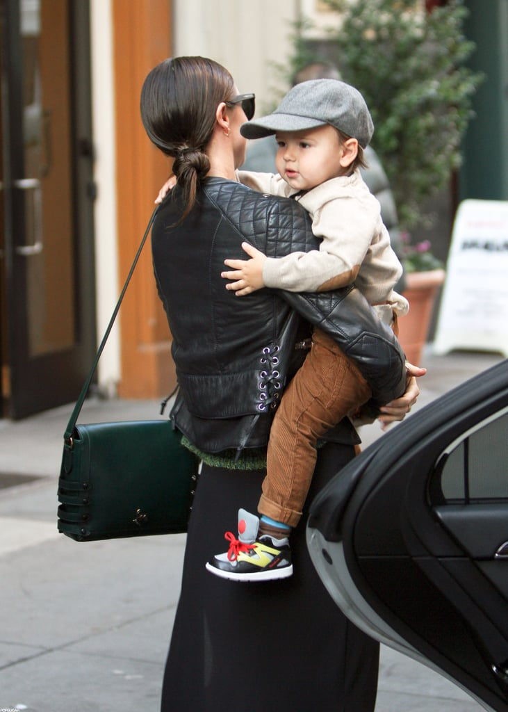 Miranda Kerr left her NYC apartment building with Flynn in her arms.